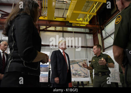U.S. President Donald Trump is given a briefing on the Border Wall prototypes by Yuma Sector Chief Patrol Agent - Stock Photo