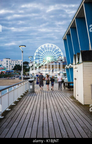 BOURNEMOUTH, UK - AUGUST 22, 2017: People walk on Bournemouth Pier on a summers evening - Stock Photo