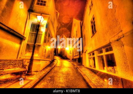 Town of Dartmouth, England. Picturesque night view of Dartmouth's Smith Street on a wet winters evening. - Stock Photo