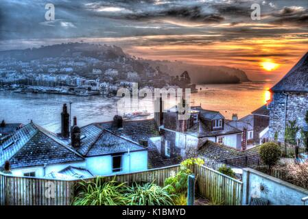 Town of Dartmouth, England. Elevated sunrise rooftop view of Dartmouth and the River Dart, with Kingswear in the - Stock Photo