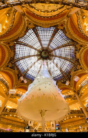 Galleries Lafayette Haussman interior with glass cupola at Christmas. Paris, France - Stock Photo