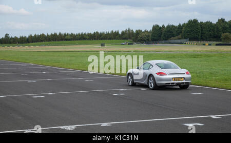 A Porsche Cayman sports car on the track at Croft Circuit, Dalton-on-Tees, North Yorkshire, England, UK - Stock Photo