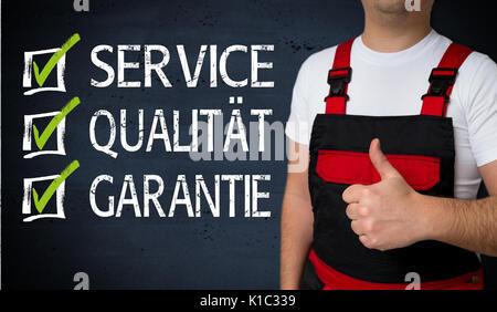 Service, Qualitaet, Garantie (in german  Service, quality, warranty) is shown by craftsman concept. - Stock Photo