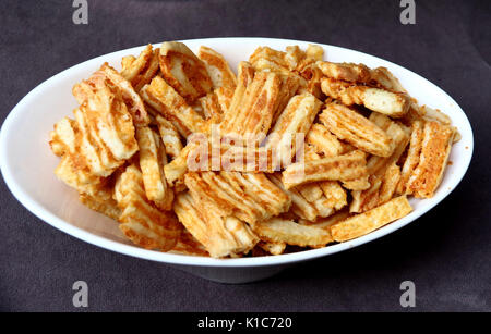 Cheddar Cheese crackers in a white bowl - Stock Photo