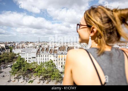 Woman enjoying view on Paris - Stock Photo