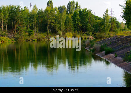 Pond chiller of the Chernobyl nuclear power plant. Dead radioactive zone. Consequences of the Chernobyl nuclear - Stock Photo