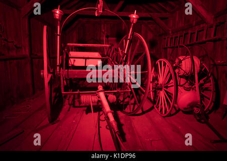 Firefighting equipment inside firehouse in Bodie State Historic Park. - Stock Photo