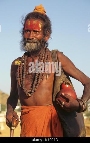 Sadhu (Hindu holy man), Pushkar Camel & Cattle Fair, Rajasthan, India - Stock Photo