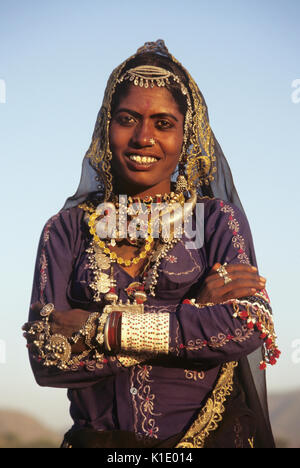 Rajasthani woman in festival dress, Pushkar Camel & Cattle Fair, Rajasthan, India - Stock Photo