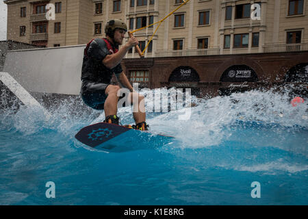 Moscow, Russia. 25th of August, 2017. A wakeboard rider jumps during openin the wake park near the Red square in - Stock Photo