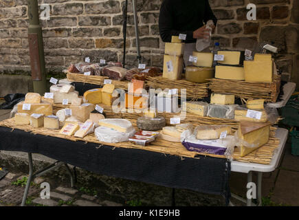 Dock Place, Leith, Edinburgh, Scotland, UK. Food stall at Leith Farmers market, with man behind cheese stall - Stock Photo