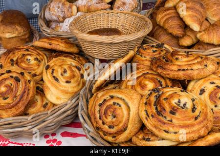 Dock Place, Leith, Edinburgh Scotland, UK. Food stall at Leith Saturday Farmers market with pain au raisin at Au - Stock Photo