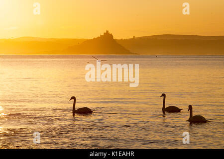 Penzance, Cornwall, UK, 27th August 2017. Sunrise in Penzance, with St Michael's Mount in the background.  Photo - Stock Photo