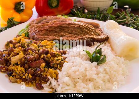 Bife de picanha arroz e feijao tropeiro - Stock Photo