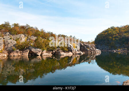 A scenic river bend in Great Falls park, Virginia, USA. Mountainous banks of Potomac River with trees in autumn - Stock Photo