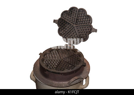 Antique cast iron waffle maker for the open fire place. - Stock Photo