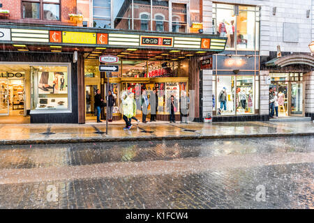 Quebec City, Canada - May 31, 2017: Old town street Saint-Jean during heavy rain with drops and sign - Stock Photo