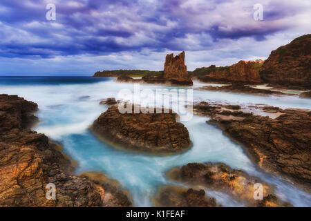 Breathing live ocean at the wateredge of Bombo beach on South coast in NSW, Australia, during sunset tide and stormy - Stock Photo