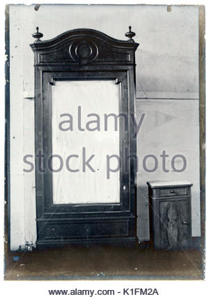 early 1900s product photo of closet with mirror - Stock Photo
