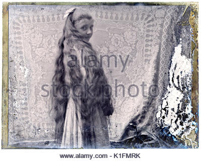 deteriorating portrait image of a young girl with very long hair  early 1900s - Stock Photo