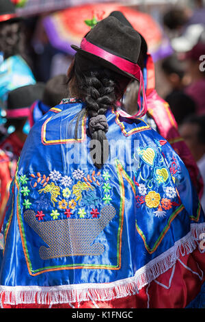June 17, 2017 Pujili, Ecuador: woman wearing a traditional embroided poncho during Corpus Christi parade - Stock Photo