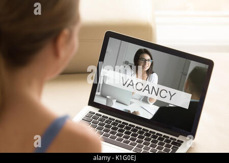 Young unemployed woman looking for job, online work search, clos - Stock Photo