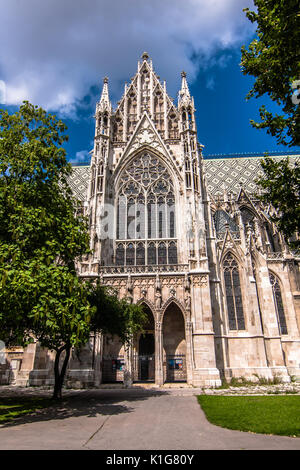 The Votivkirche (English: Votive Church) is a neo-Gothic church located on the Ringstraße in Vienna - Stock Photo