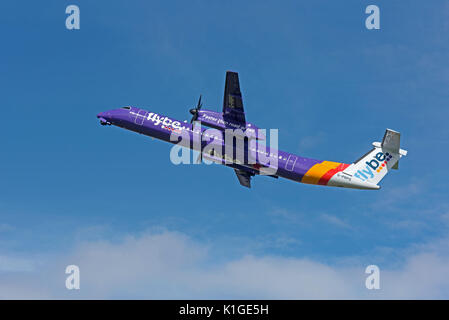 Bombardier Dash 8 Q400 departing Inverness airport in the Scottish Highlands. - Stock Photo