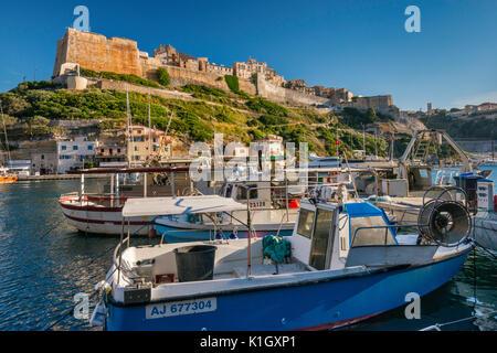 Citadelle, boats at marina at port, at sunset in Bonifacio, Corse-du-Sud, Corsica, France - Stock Photo