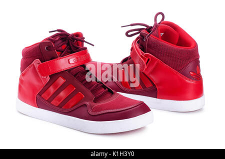 SAMARA, RUSSIA - April 13, 2017: Red Adidas sneakers for running, football, training, showing the Adidas logo and - Stock Photo