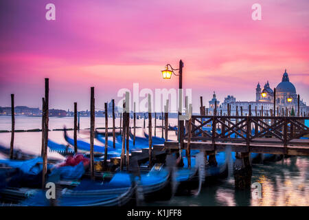 Sunset over the gondolas of Venice, Italy at St. Mark's Square. - Stock Photo
