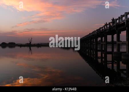 U Bein Bridge and Lake Taungthaman at sunset, Amarapura, Myanmar. - Stock Photo
