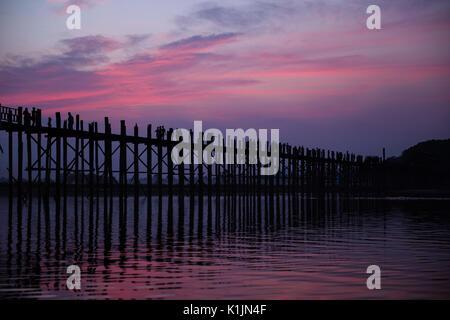 U Bein Bridge on Lake Taungthaman at dusk, Amarapura, Myanmar. - Stock Photo