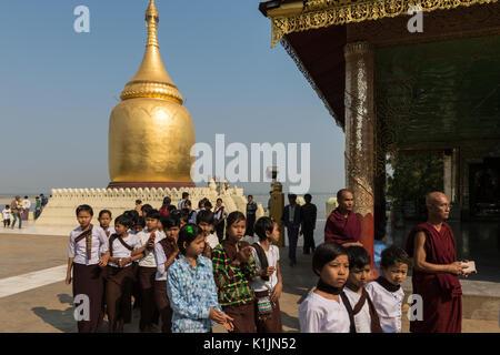 A group of schoolgirls visit Bupaya Temple in Old Bagan, Myanmar. - Stock Photo