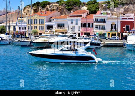 Small motorboat yacht Mahon Menorca Minorca - Stock Photo