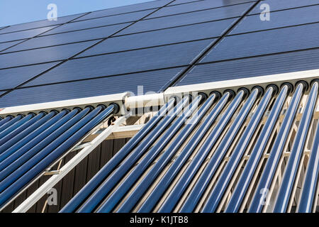 Solar Thermal Flat Panels with Evacuated Tube Collectors. Many companies are installing renewable energy sources - Stock Photo