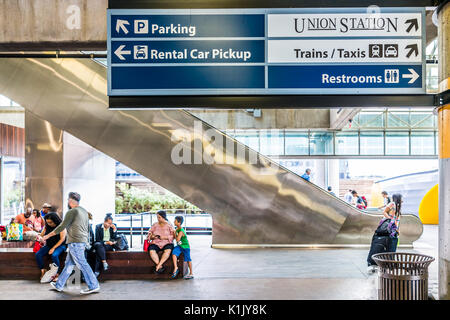 Washington DC, USA - July 1, 2017: Inside Union Station parking garage for buses in capital city with people walking - Stock Photo