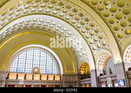Washington DC, USA - July 1, 2017: Inside Union Station in capital city with transportation signs and people walking - Stock Photo