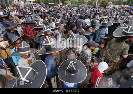 June 29, 2017 Cotacachi, Ecuador: indigenous men wearing extra large sombreros dancing in  the main square of the - Stock Photo