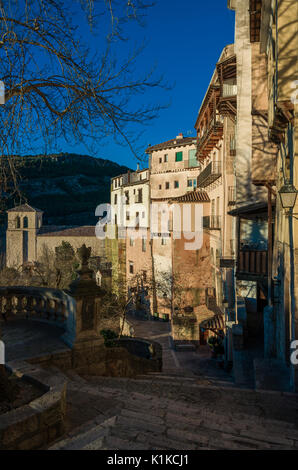Cuenca, Spain - December 29, 2016: Typical streets and buildings of the famous city of Cuenca in sunset, Spain - Stock Photo