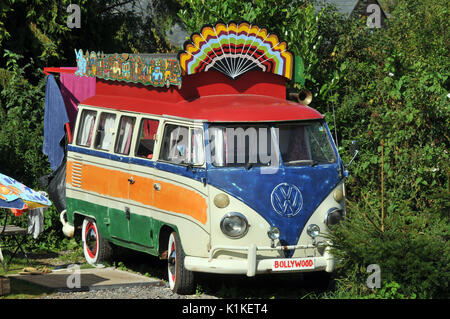 a Volkswagen vw camper van painted in multiple colours multi-coloured vans for camping and designed to live in short - Stock Photo