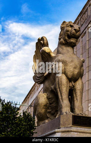 A winged lion statue with the Grove Arcade in the background in Asheville, North Carolina USA - Stock Photo