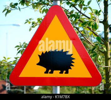 Warning sign, crossing hedgehogs, Scania, Sweden - Stock Photo