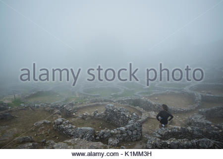 Female Hiker at Santa Tecla in Fog, A Guarda, Spain - Stock Photo