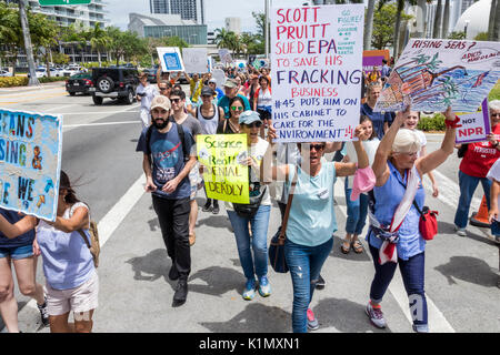 Miami Florida Museum Park March for Science protest rally sign protester marching signs posters - Stock Photo