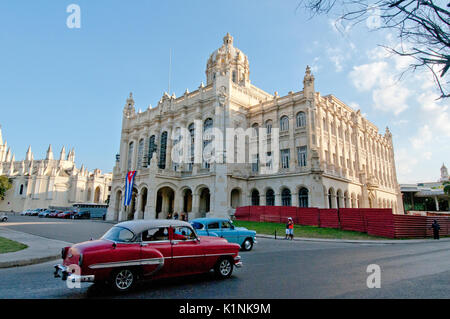 Classic 1950's American cars in front of the Presidential Palace in Havana Cuba - Stock Photo