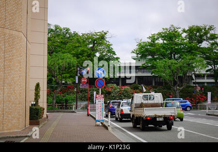 Akita, Japan - May 18, 2017. Vehicles run on main street at downtown in Akita, Japan. Akita is a large prefecture - Stock Photo