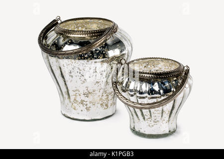 CLOSE UP IMAGE OF TWO DECORATIVE ROUND RUSTIC SILVER AND GOLD CRACKLED GLASS BUCKETS CANDLE HOLDER ISOLATED ON WHITE - Stock Photo