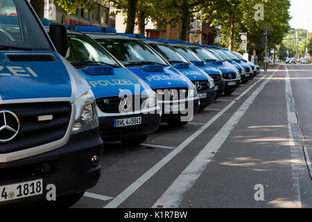 A line of Mercedes police cars parked outside a place station on a street in Stuttgart, Germany, Europe - Stock Photo