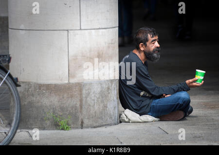 Begging on the streets of German City Erfurt in the regional state of Thuringia, - Stock Photo